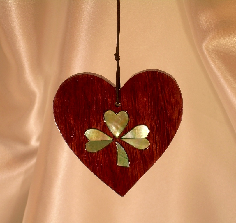 Purpleheart wood heart with golden Mother-of-Pearl split shamrock inlay tinted green