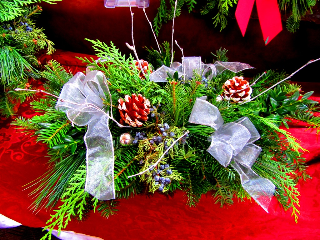 log container centerpiece with mixed evergreens