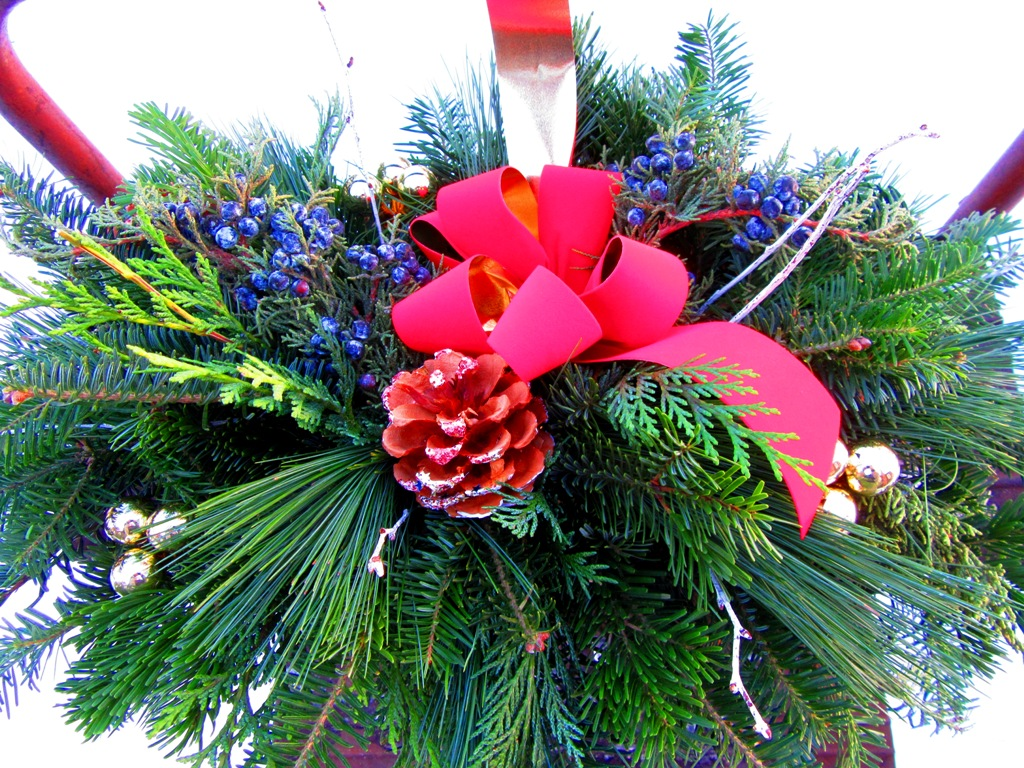 mixed evergreen centerpiece arrangement also in log container