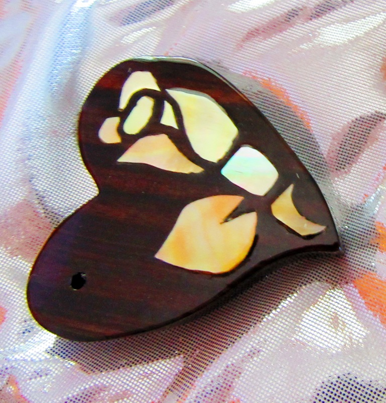 """3"""" Ebony wood heart with Golden Mother-of-Pearl rosebud inlay that hangs askew"""
