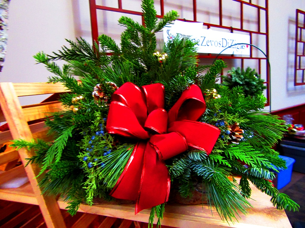 log basket with wired red velvet bow, mixed evergreens (Silver Fir, White Pine, Cedar, Juniper) with gold balls, white-tipped cones and gold balls