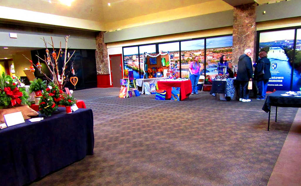 Dizigns booth, Soul Sisters Studio booth, the huge city posters and the raffle table