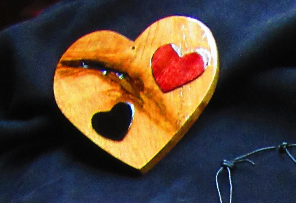 "A customer who preferred not to be photographed bought this 5"" Cherry heart with an Ebony and a Purpleheart heart inlay. I told her my mission with my art and her own heartfelt story about why she was buying this heart made me fight back the tears. This big heart with the imperfection in it made it more beautiful, and that was what she felt about the receiver of this gift."