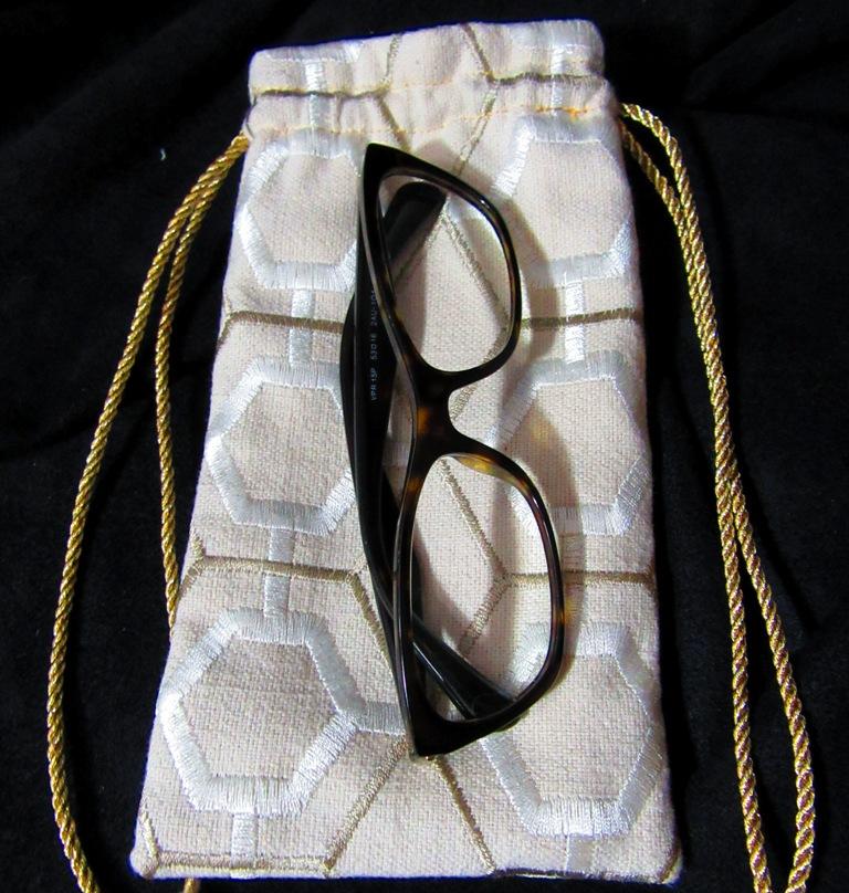 flatonblackwhitesidewithglasses.JPG