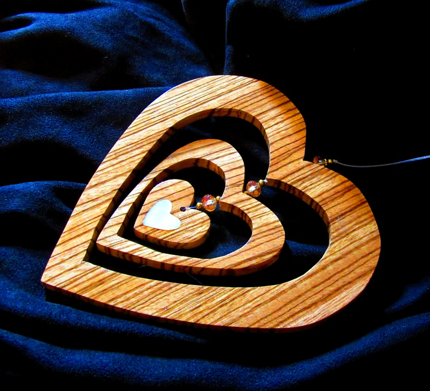 3 Heart Hanging Zebrawood piece with pearl heart inlay and beads