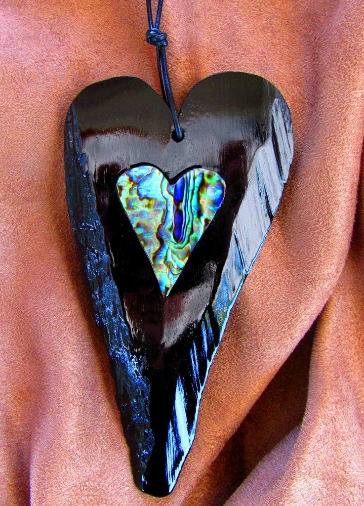 Elongated Ebony heart with raw edge and Abalam heart inlay