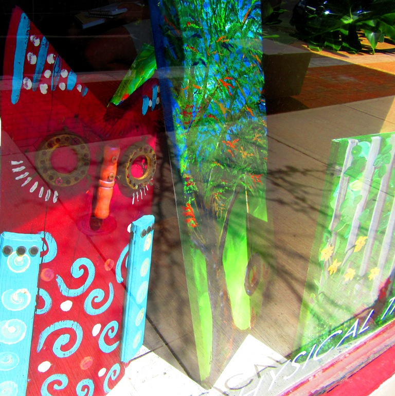 storefront window with the artwork of Pam Urda of Artified Relics