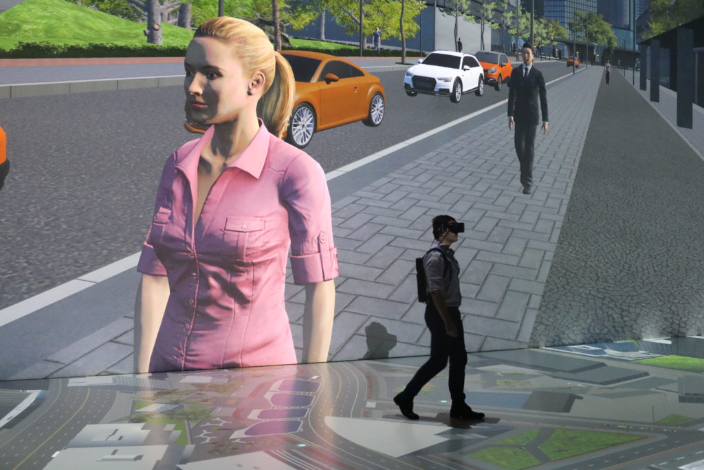 Humans interacting with virtual pedestrians within the urban simulation. Source: TUMCREATE + Ars Electronica