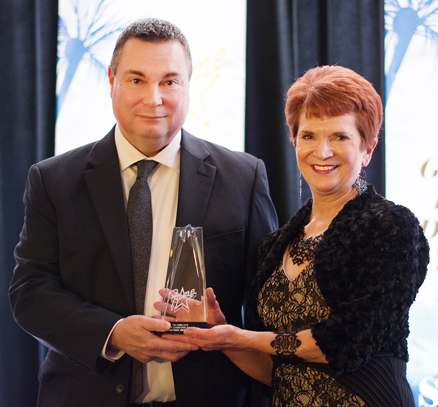 Ken Yant is pictured with Mary Begalle of Schwan's Food Company, one of the FAME sponsors