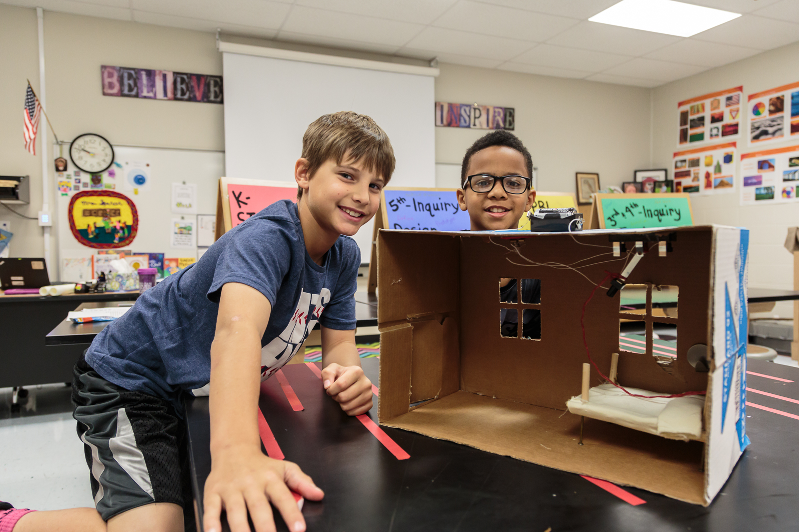 "Future electrical engineer  Noah  (right) and partner  Chase , both 4th graders, designed ""The Rever,"" a lever to turn off the lights from the comfort of bed. ""We don't like getting out of bed [once comfortable]… to turn off the light. And then you come back and you can't get comfortable again,"" says Noah of their inspiration."