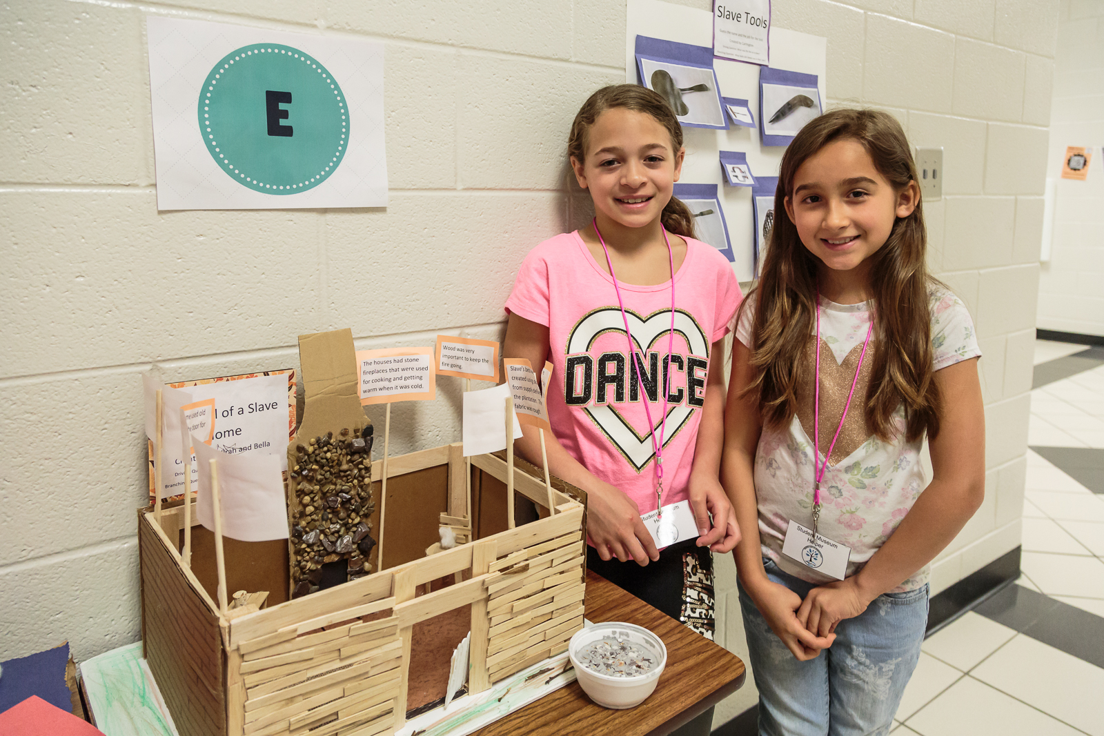 Students  Bella, Kira, Carrington,  and  Tristan  worked as a team to depict the lives of plantation slaves.