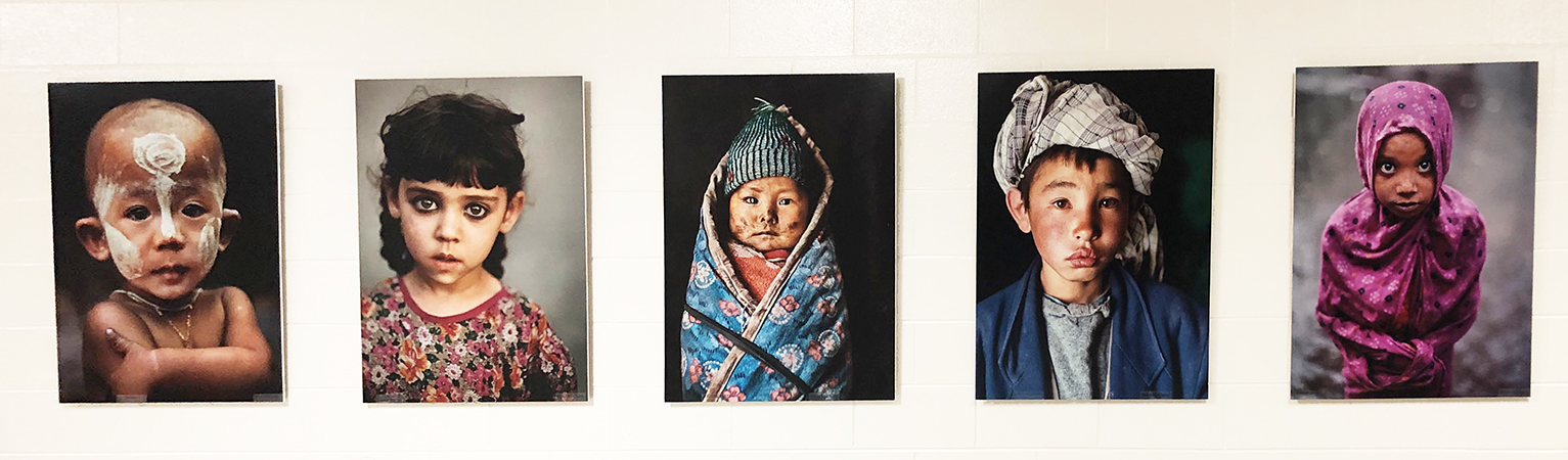 Row of five photo portraits of children