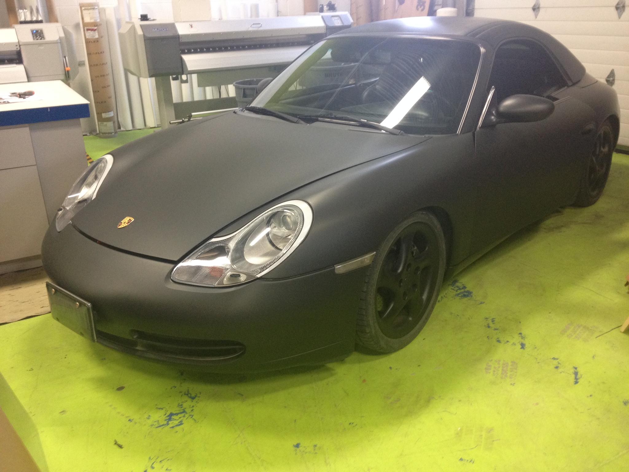 Porsche matte black vinyl wrap