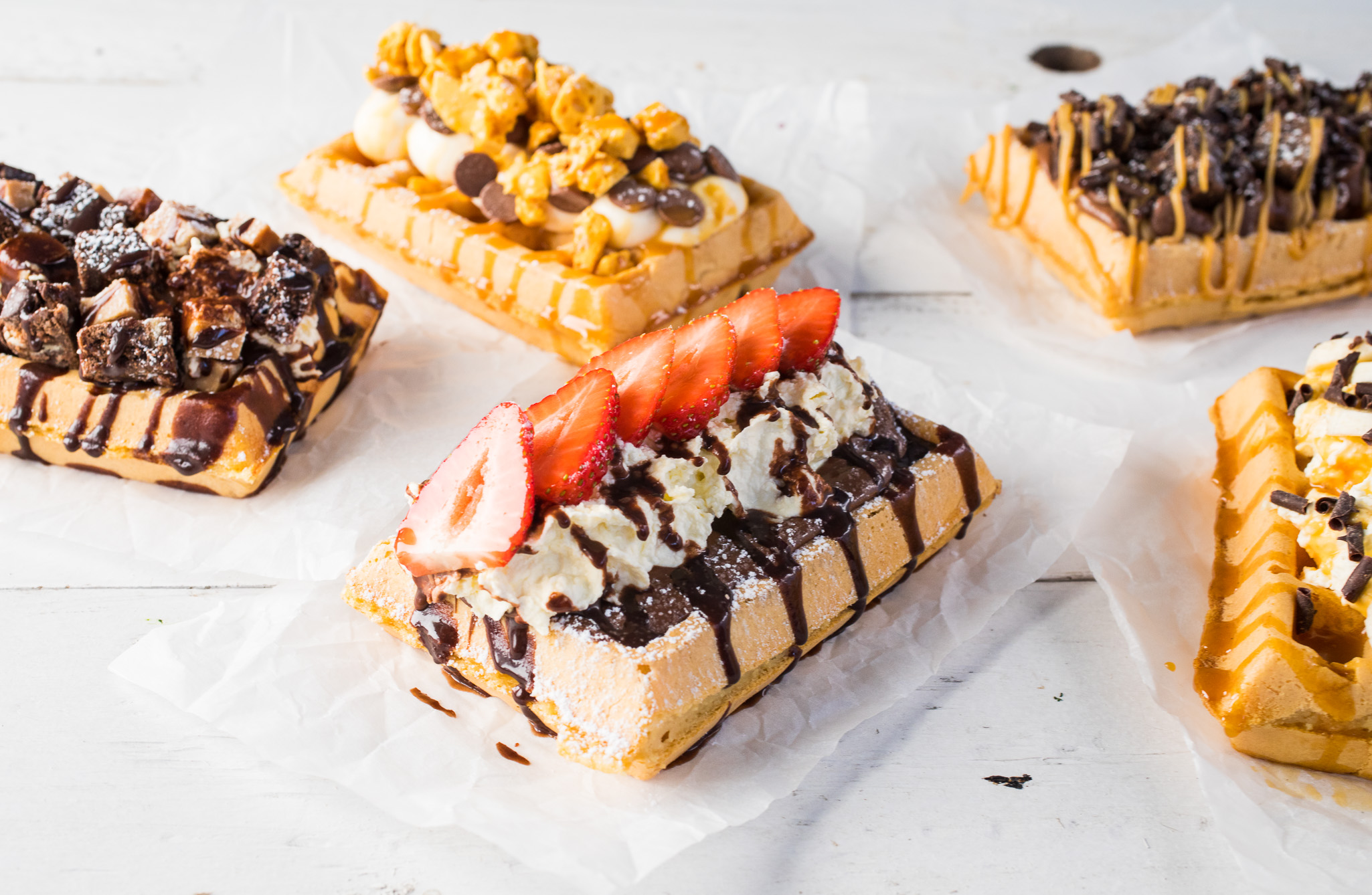 The waffles - All our waffles are baked fresh to order. Malted Belgium waffles topped with some classic topping and some unique