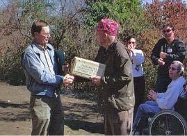 Ron Brown handing award to man at Fred Wilder Observation Deck