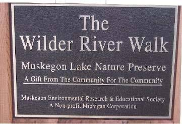 "Plaque: ""The Wilder River Walk; Muskegon Lake Nature Preserve; A Gift From The Community For The Community; Muskegon Environmental Research & Educational Society; A Non-profit Michigan Corporation"""