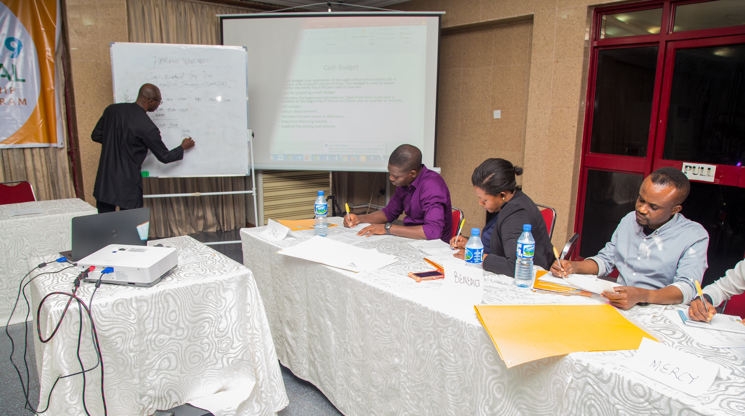 Mr Perry from the UNFPA taking the entrepreneurs on financial feasibility; Sales Estimation, Cost and Break-Even Analysis