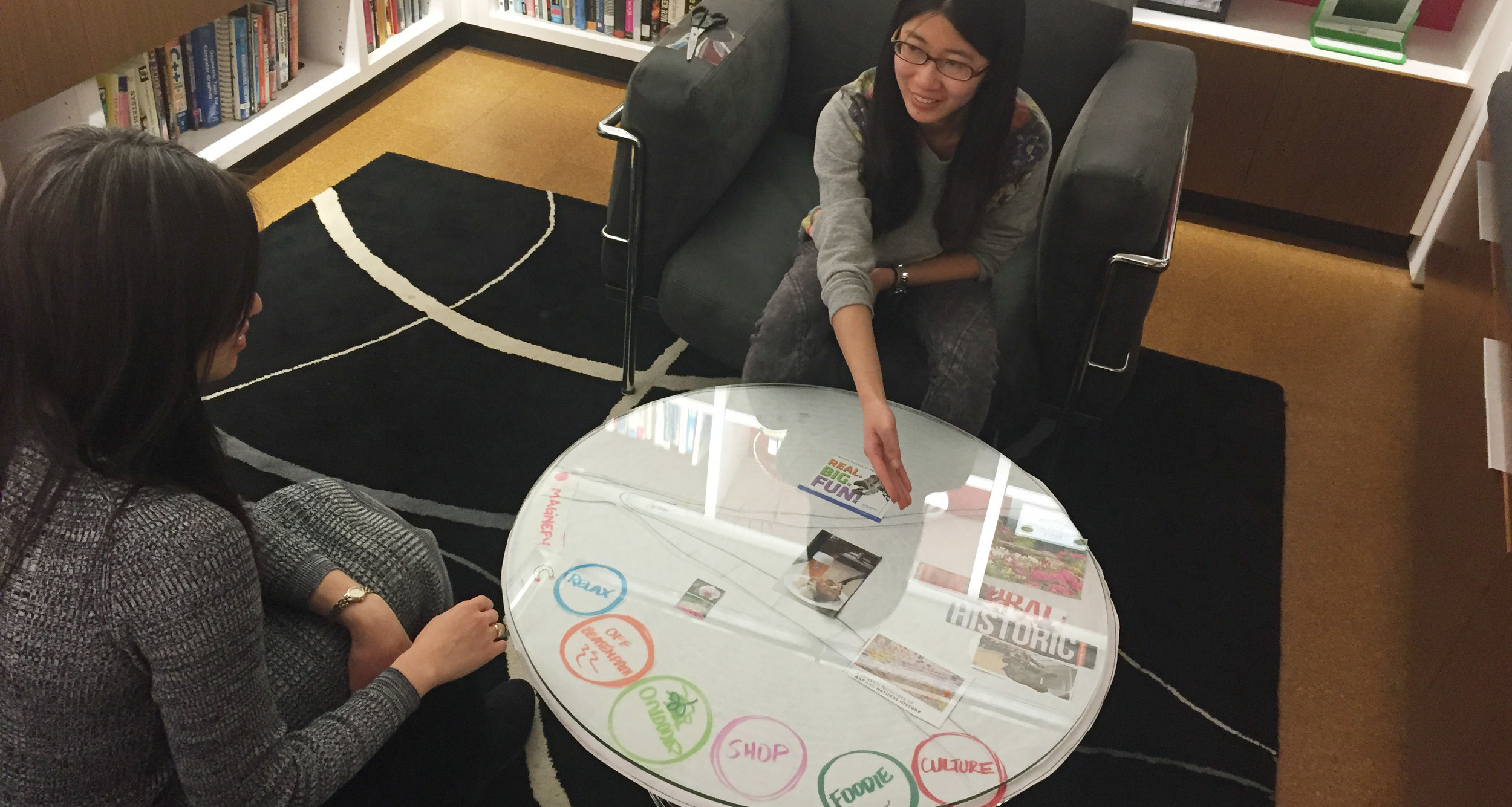 An interactive table at the hotel where guests can pick and choose tourist attractions according to their interests.