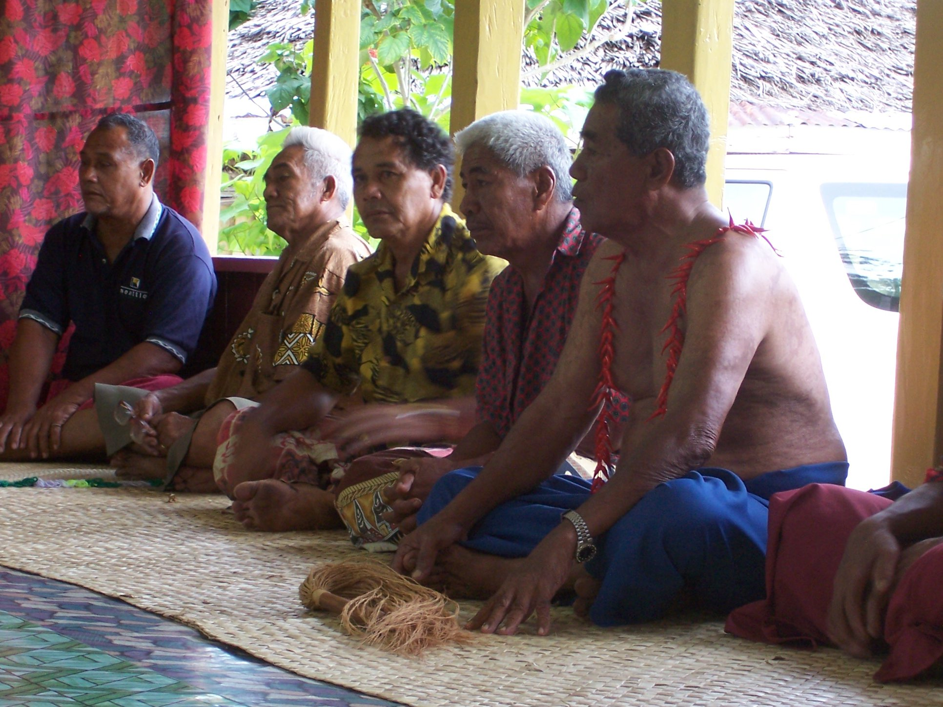 The village chiefs -  The village of Tufutafoe was where Maril's grandfather was born in 1905. All of the people in the village are Afualos. These are some of the distant relatives that serve on the village council who were invited inside the fale, for the ceremony. They were completely comfortable sitting cross-legged on the mats for the lengthy ceremony.