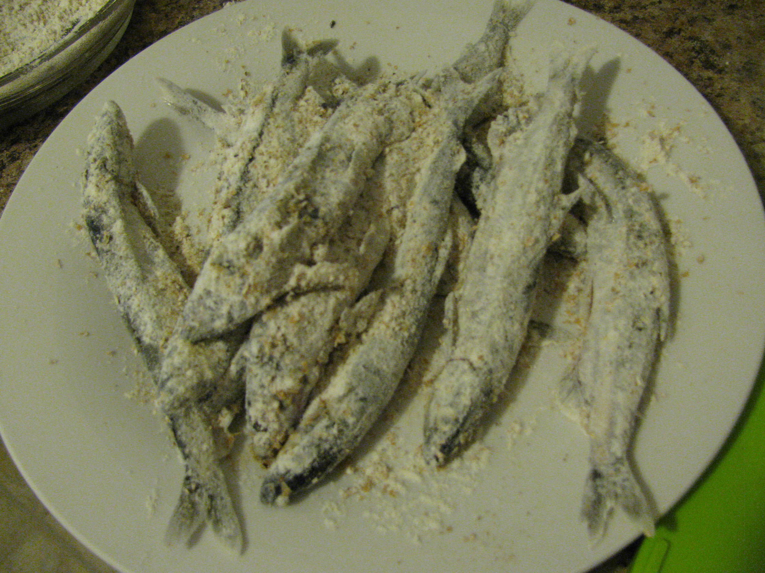 Preparing the capelin for frying