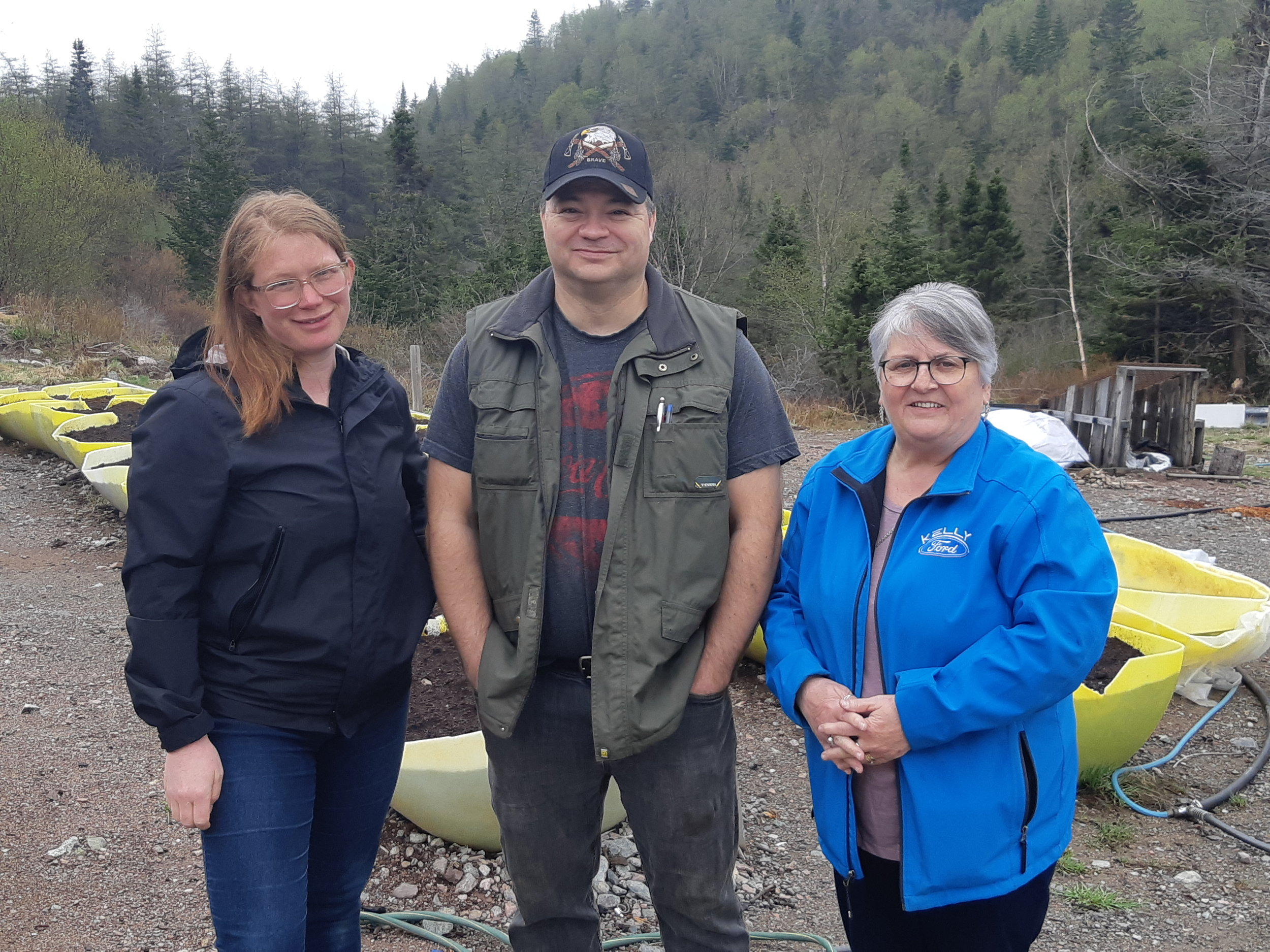 Sarah Crocker, Tim Drew, and Josephine Marshall at the Pool's Cove Community Garden.