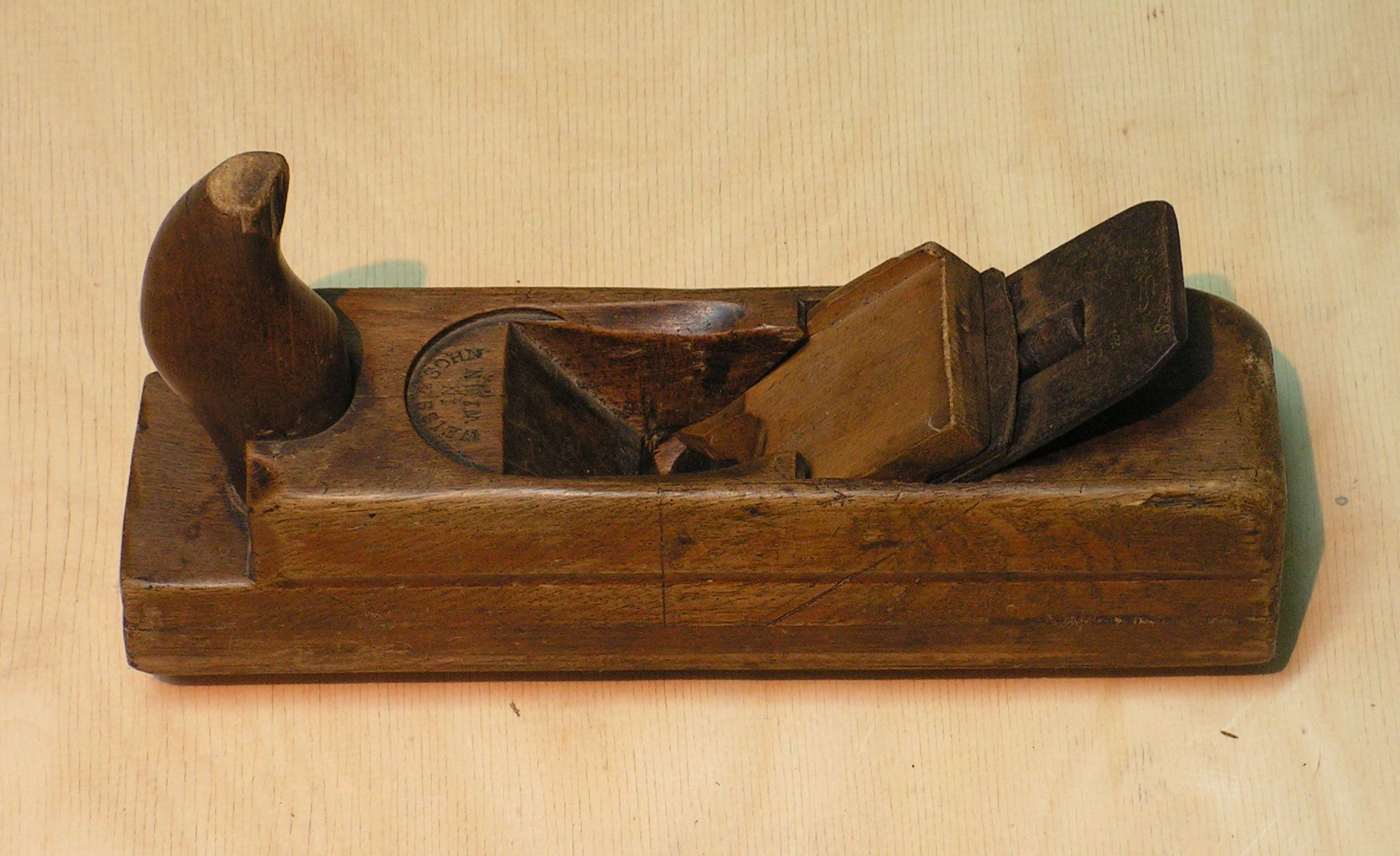 Hand held wooden plane for routing and carving