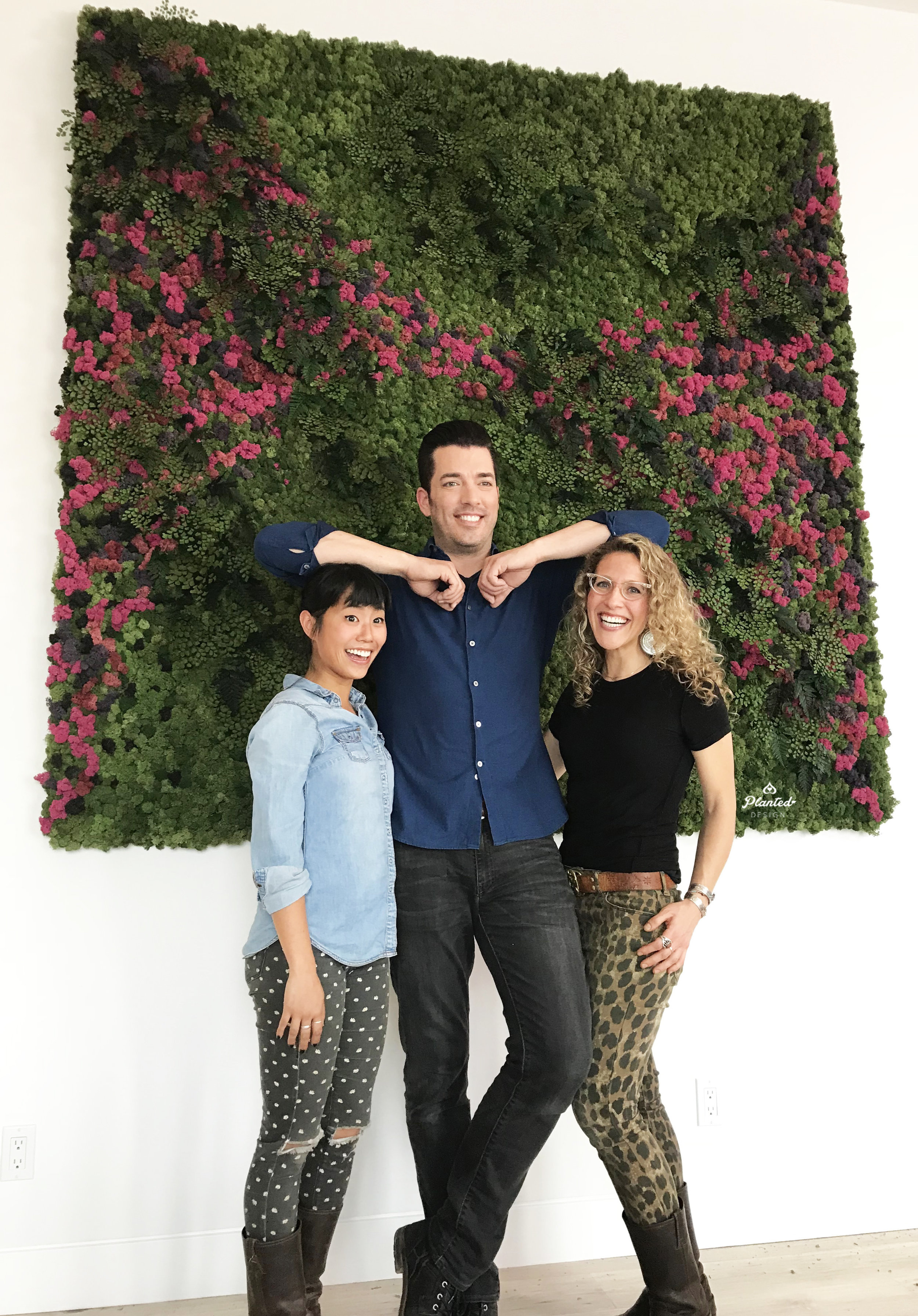 Accounts Manager & Designer, Lucy (left), and CEO & Founder, Amanda (right), pose during the installation phase with host, Jonathan Scott.