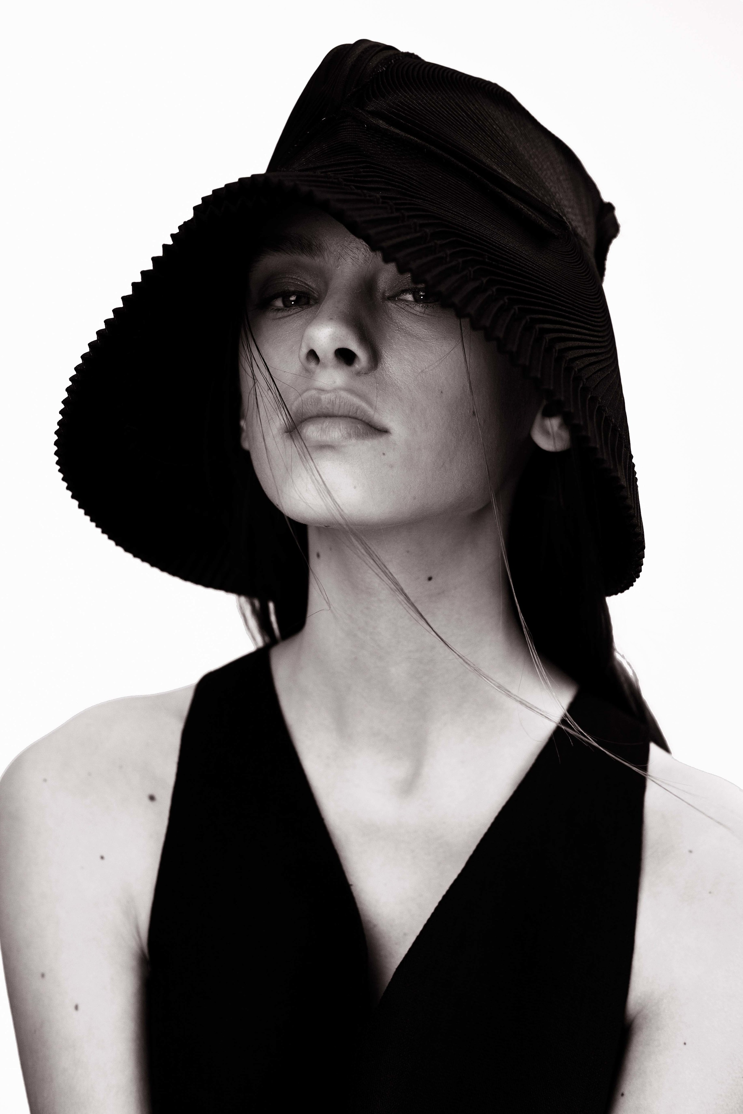 Hat by Issey Miyake  Top by Whistles