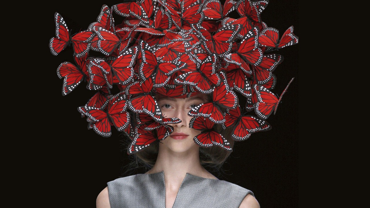 Detail: Butterfly headdress designed by Philip Treacy for Alexander McQueen ' La Dame Bleu ' SS'08 Collection. Photo by Anthea Simms