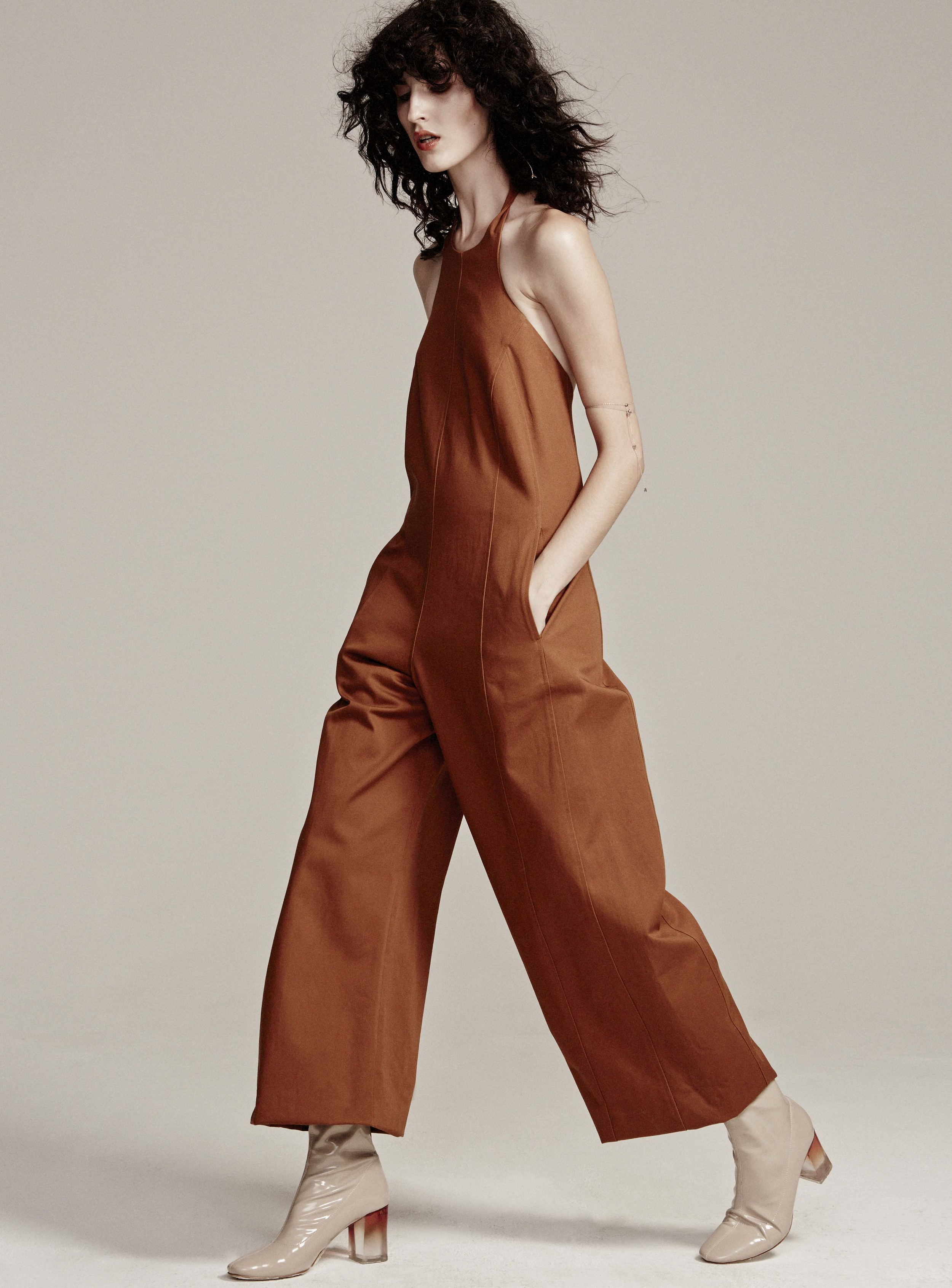 Jumpsuit by Maryam Nassir Zadeh, Earring ,  Rings and Necklace (worn around arm)  by Lorae Russo,  Stylist's own Boots