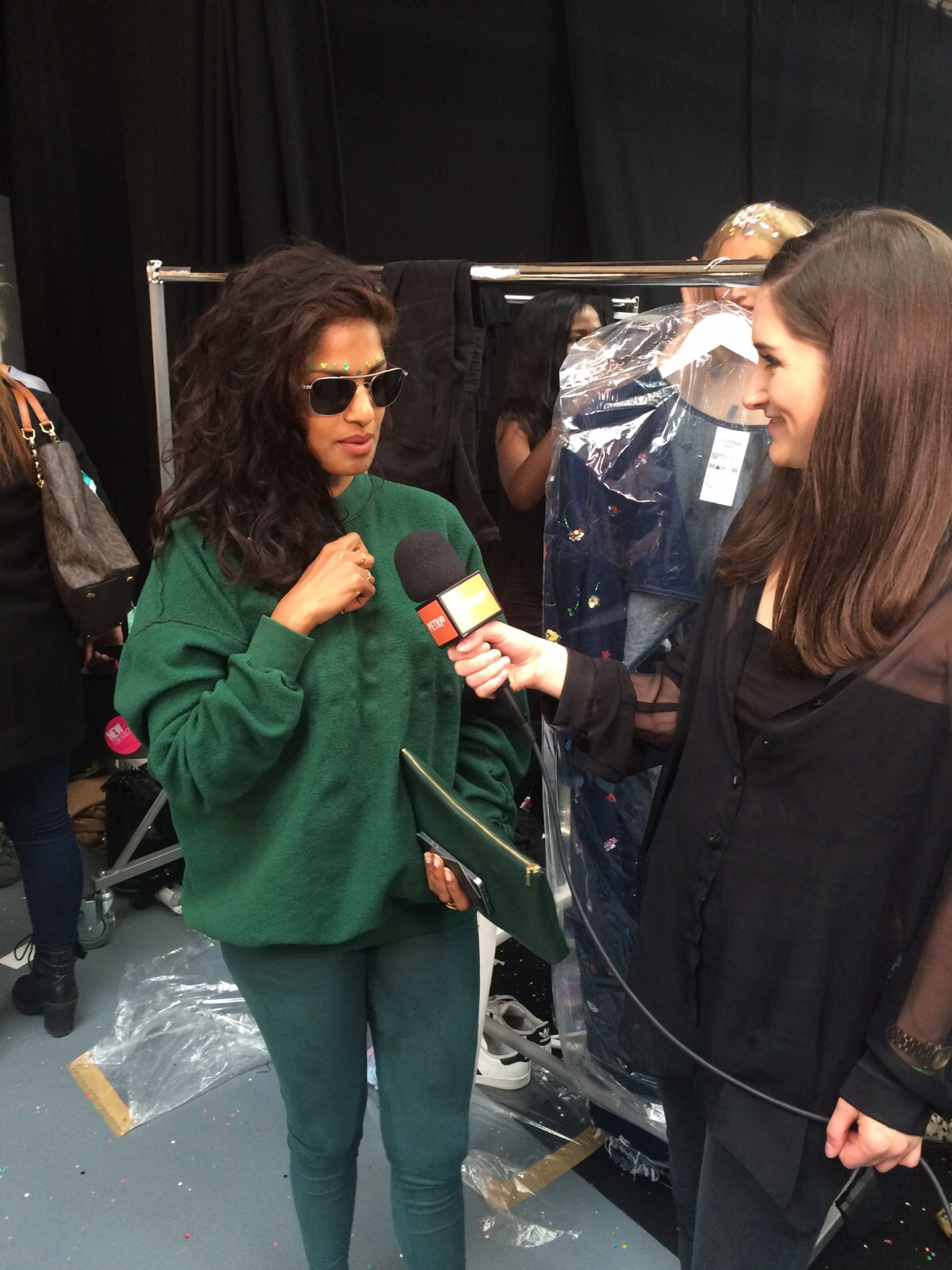Elizabeth Neep speaking with rapper and songwriter M.I.A, backstage at Ashish SS'16 show