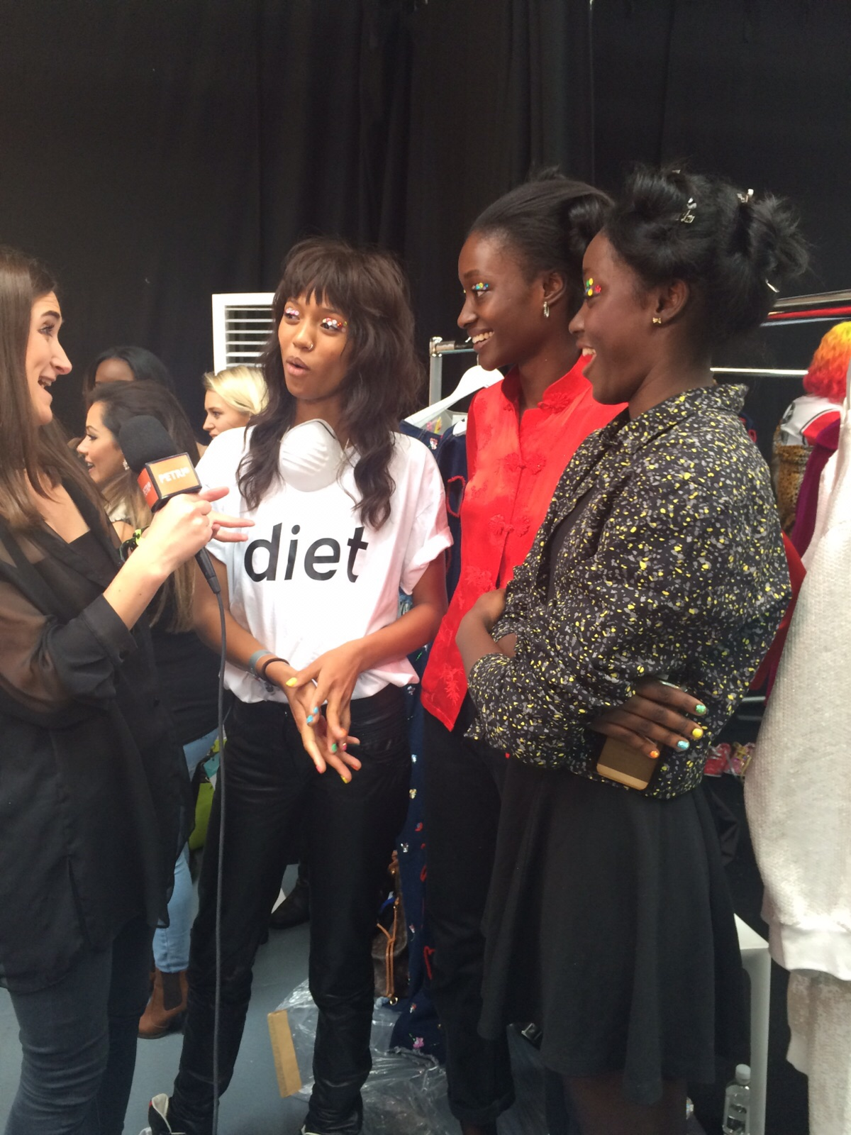 Elizabeth Neep speaking with models: Adesuwa Aighewi,Sienna King and Maddie Seisay backstage at    Ashish SS'16 show