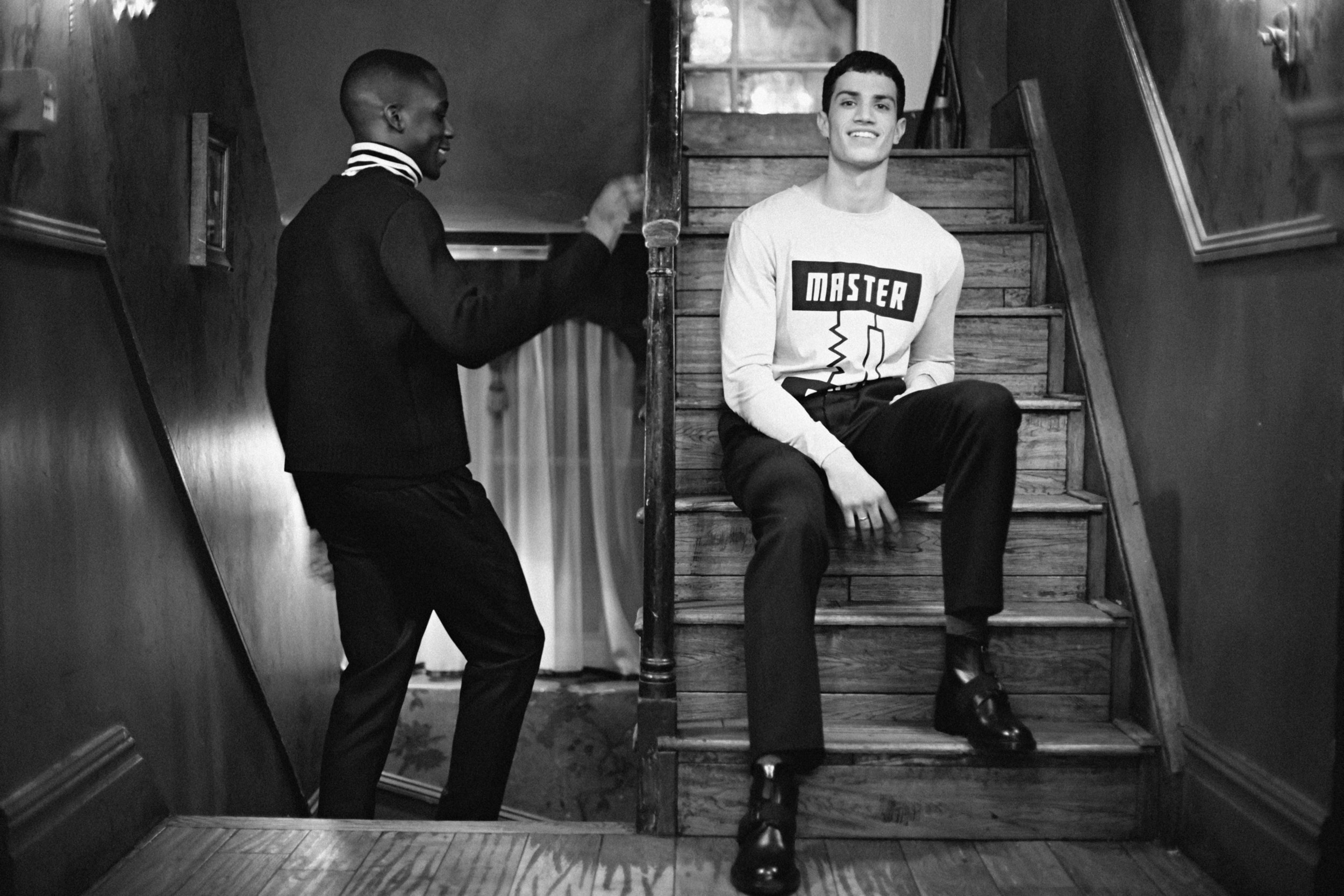 Emmanuel wears Jumper by Craig Green, Turtleneck worn underneath by Esk, Trousers by Christopher Kane and Sneakers by ISSEY MIYAKE MEN  Ashton wears Long Sleeve Top by Studio White Label, Trousers by Markus Lupfer and Boots by Christopher Kane