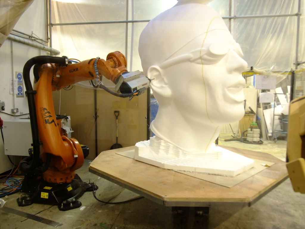 KUKA Robot arm sculpting giant swimmer's head