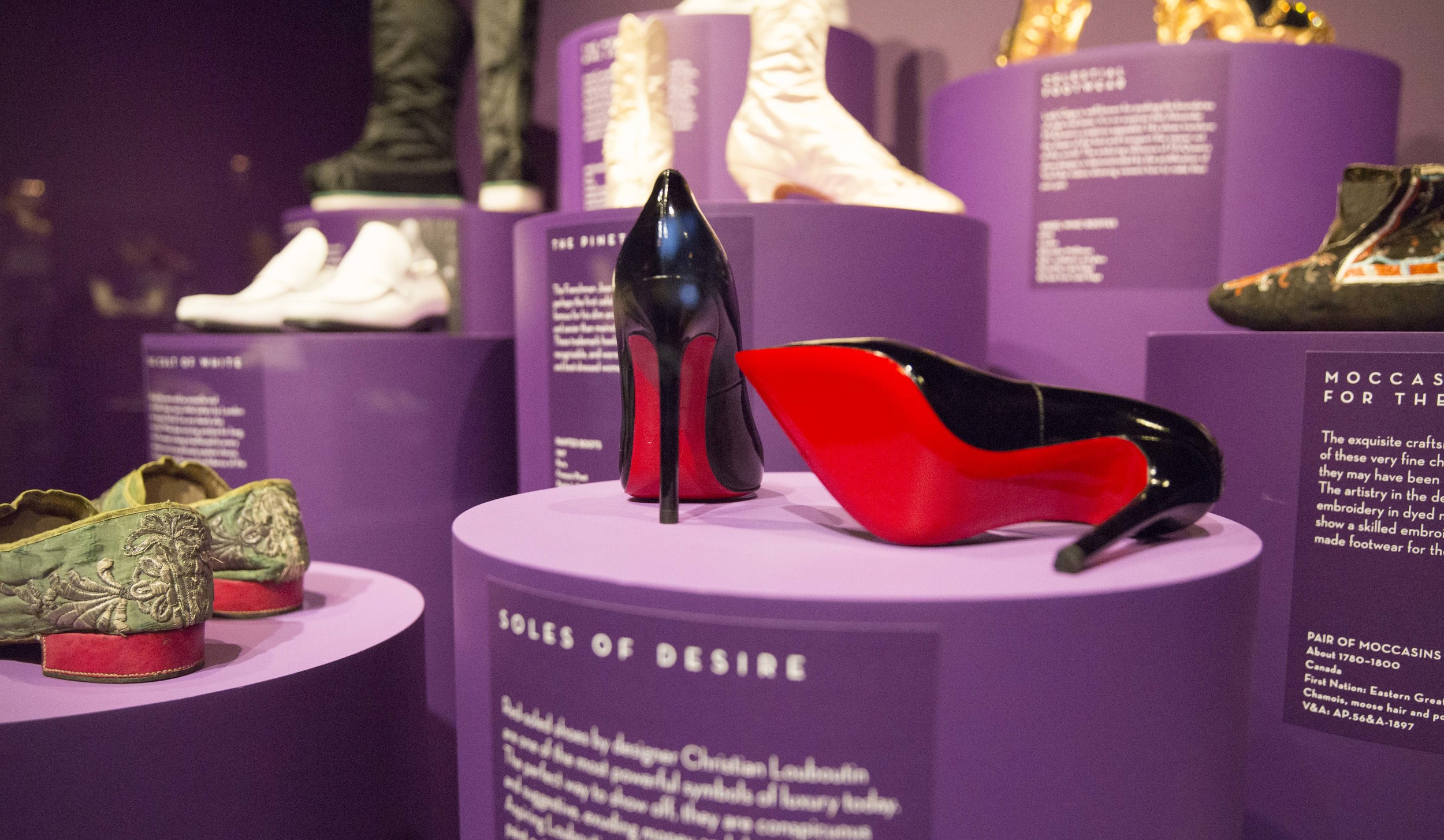 Christian Louboutin 'Pigalle' pump. Installation view of  Shoes: Pleasure and Pain