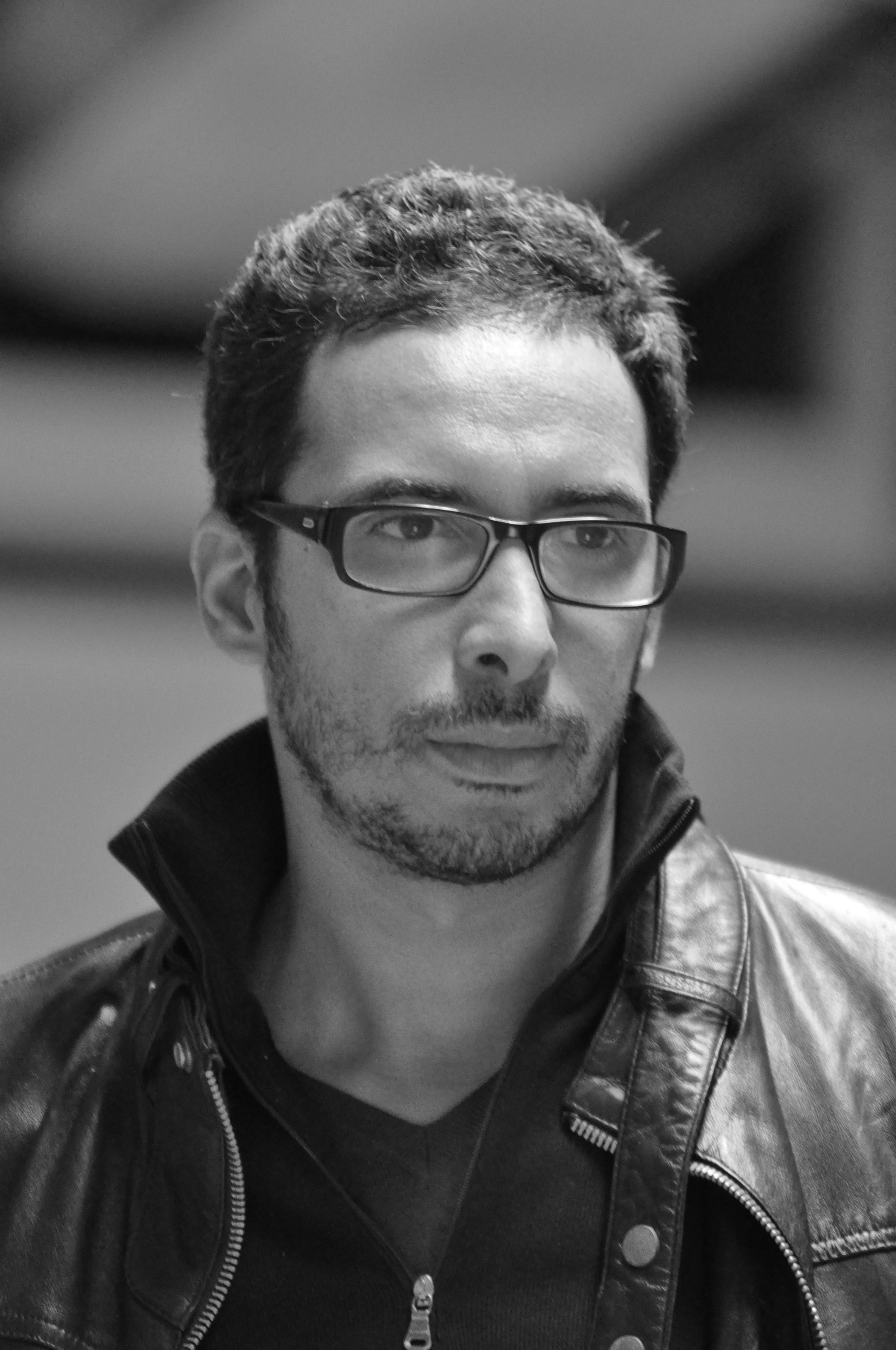A portrait of Mounir Fatmi