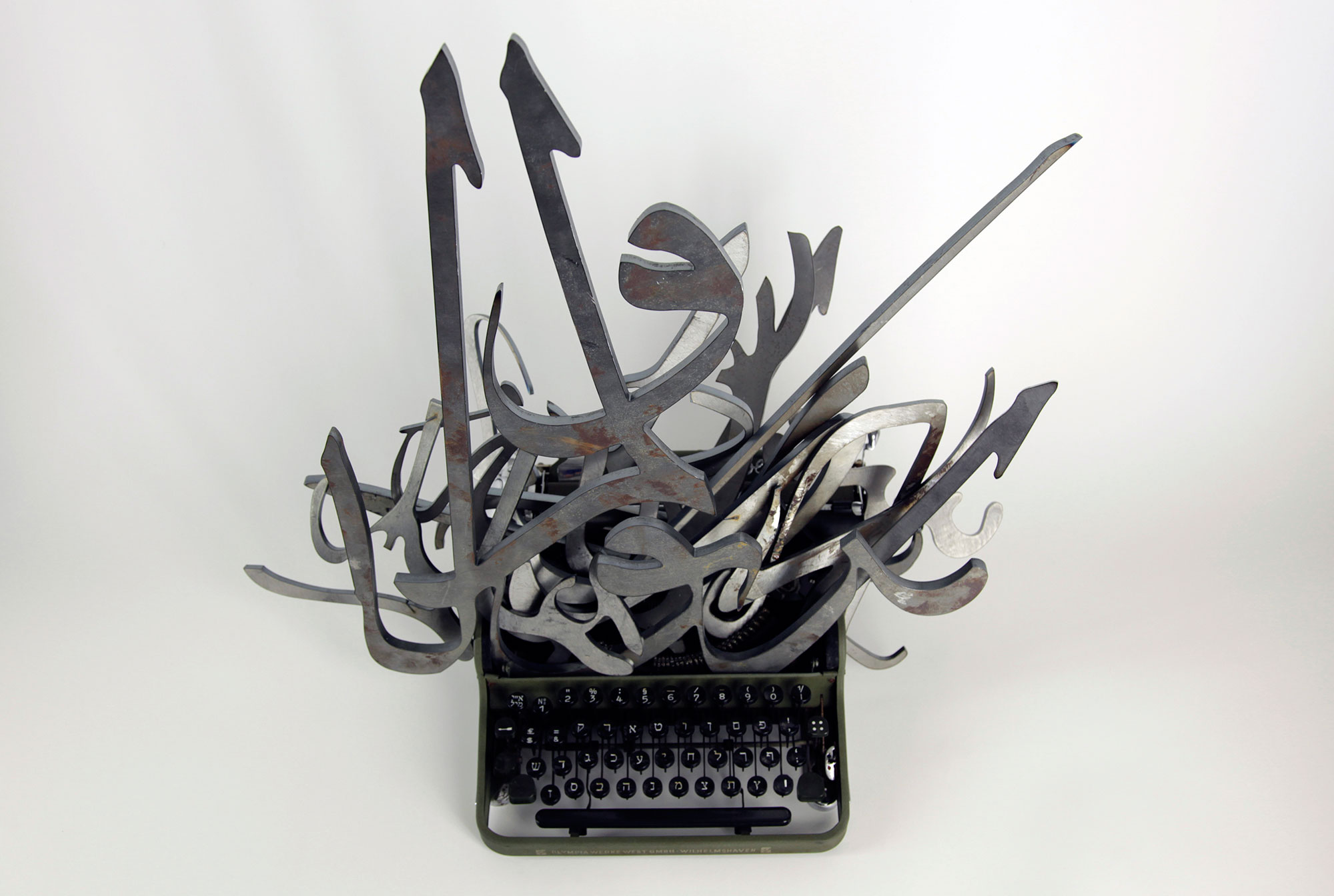 The Impossible Union , 2011, arabic calligraphies of steel, hebrew typewriter.Courtesy of the artist and Collection of the Kunstpalast Museum, Duesseldorf. Photo credit : Mounir Fatmi