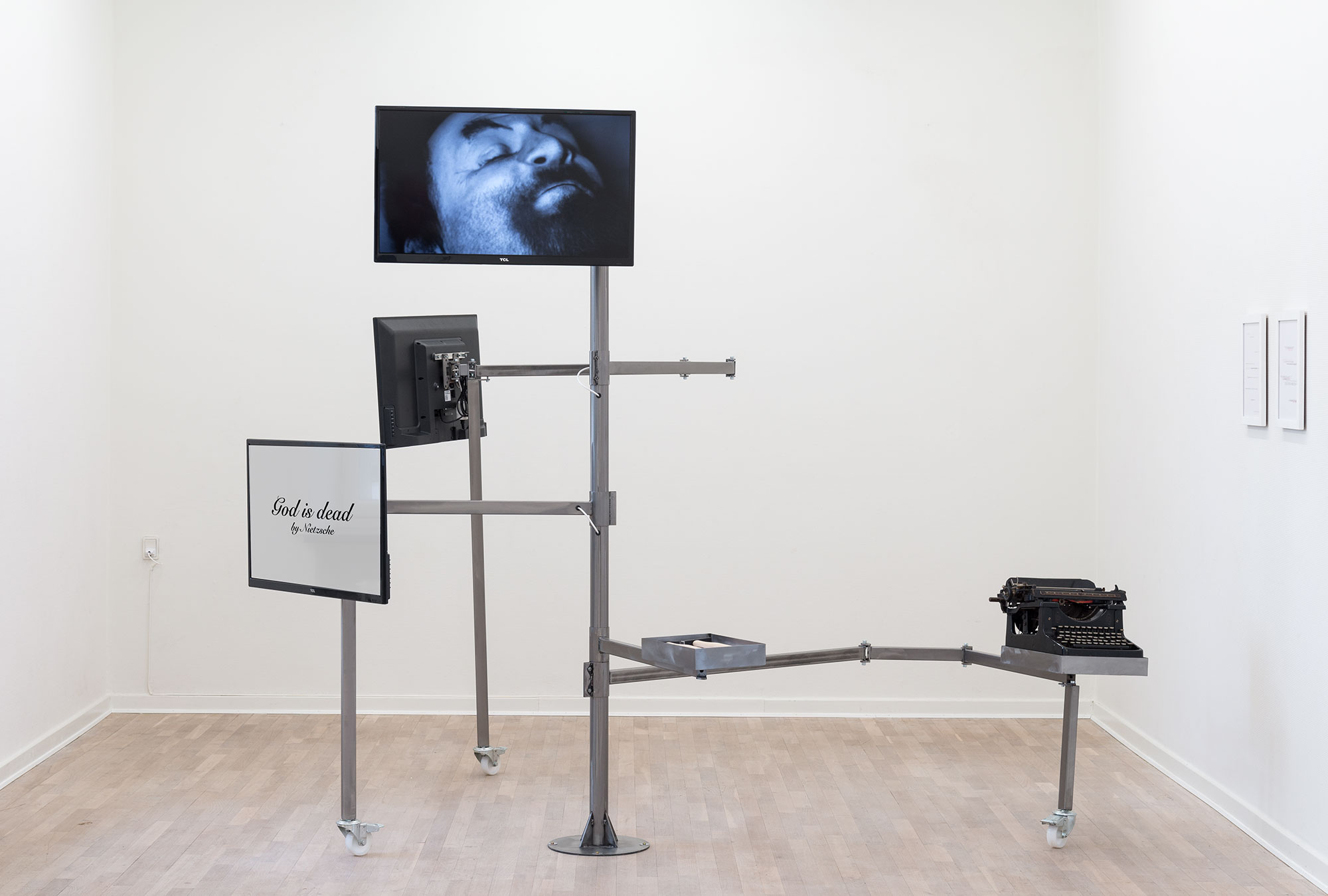 Deconstruction Structure N°1 , 2013-2014, Typewriter, hammers, A4 paper on office desk, video on flatscreen, Bilboquet game, typed sheets.Courtesy of the artist and Goodman Gallery, Johannesburg-Cape Town.Exhibition view from Merchant of Dreams.Photo credit : Viborg Kunsthal