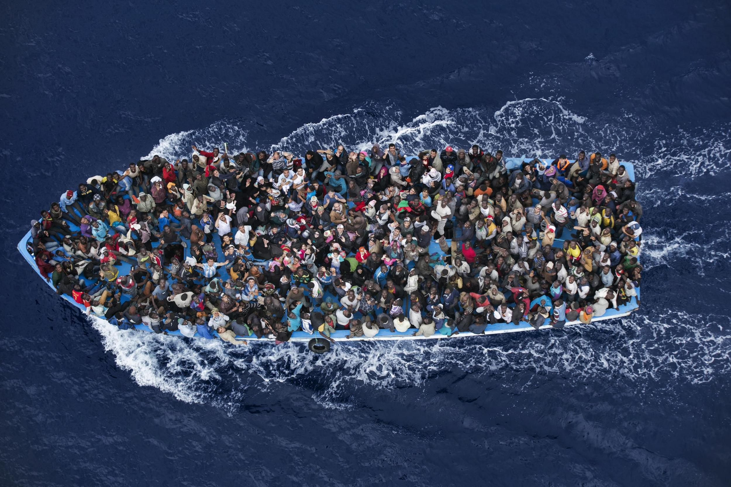 Asylum seekers from Africa traveling by boat in the Mediterrancean, 2014. Photo by Massimo Sestini