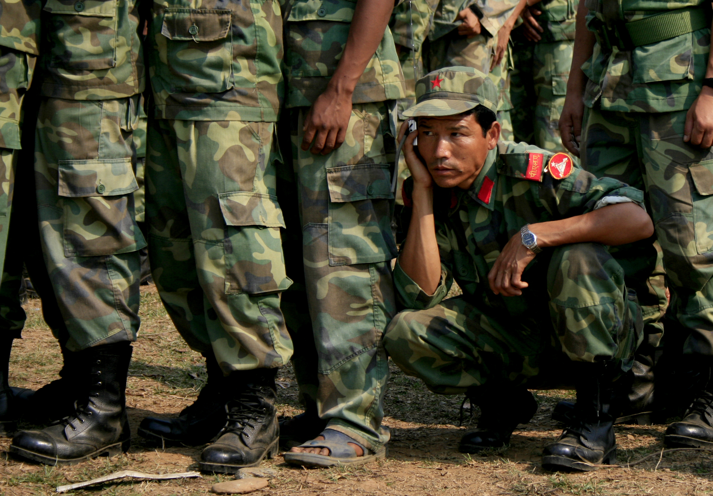 Maoist soldier listens to radio news updates attentively during the Nepalese constituent assembly election, 2008. Photo by Rashmi Thapa
