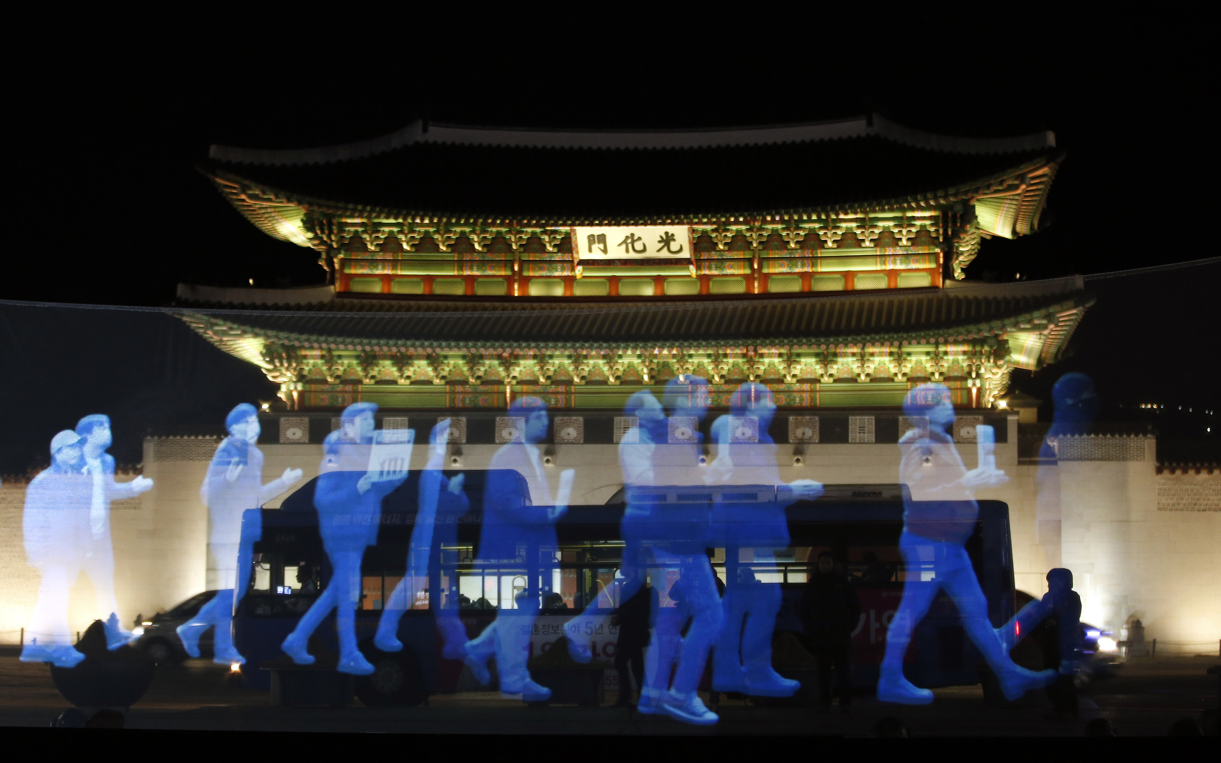 "A holographic ""ghost protest"" held in South Korean capital Seoul against the erosion of free speech in the country. Photo by Associate Press, February 2016."