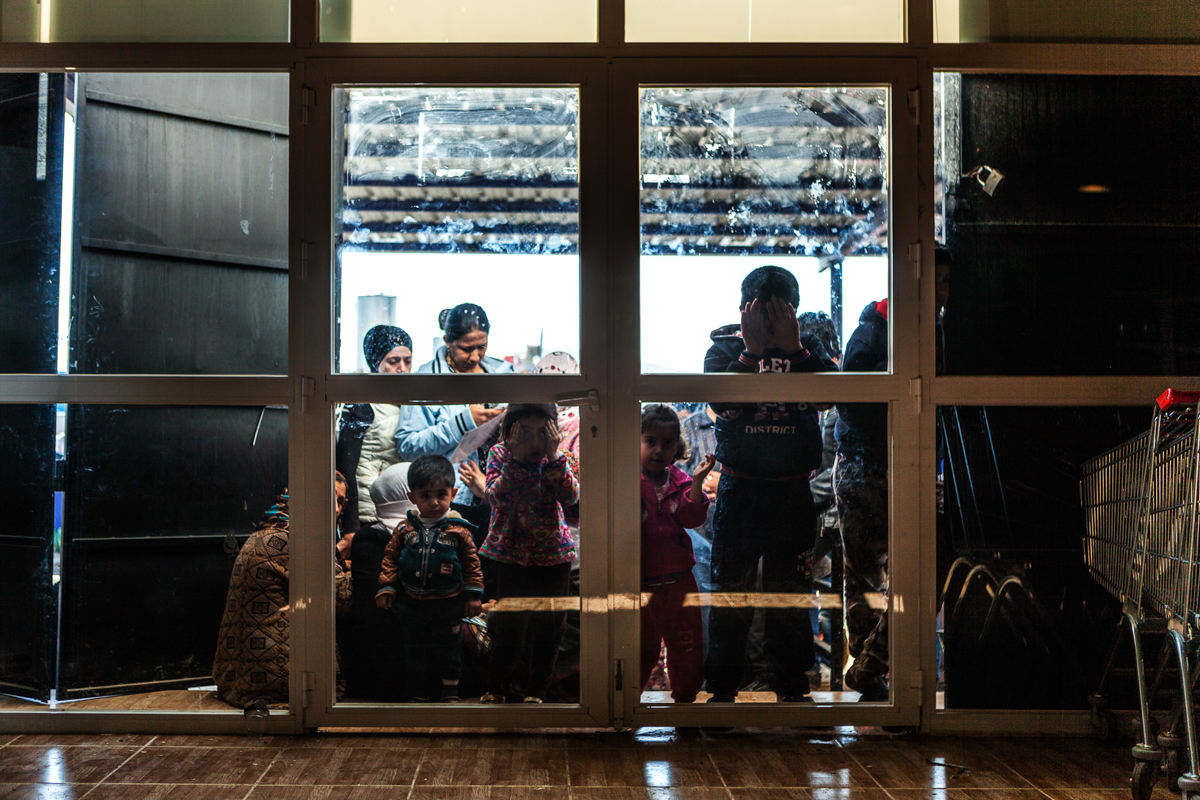 Syrian families wait for a supermarket in Kawargosk Refugee Camp to open.Kawargosk Refugee Camp, Erbil, Iraq. February 15, 2016. Photo by Danish Refugee Council/Eduardo Soteras Jalil.
