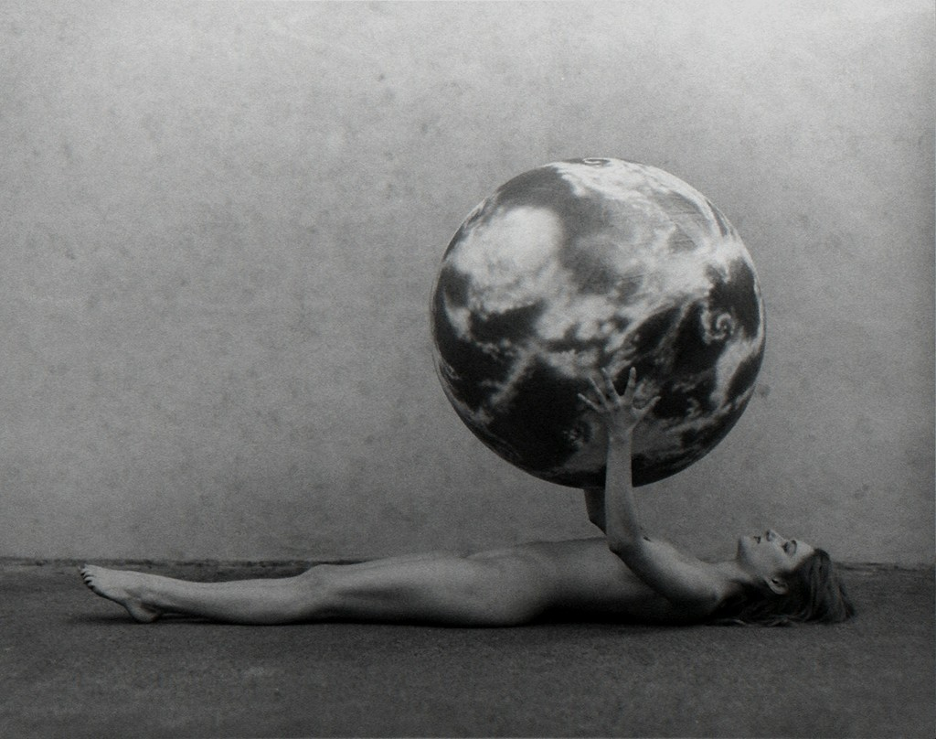 Undated photograph of  Nude Woman with Model of the Earth  by Spencer Tunick.