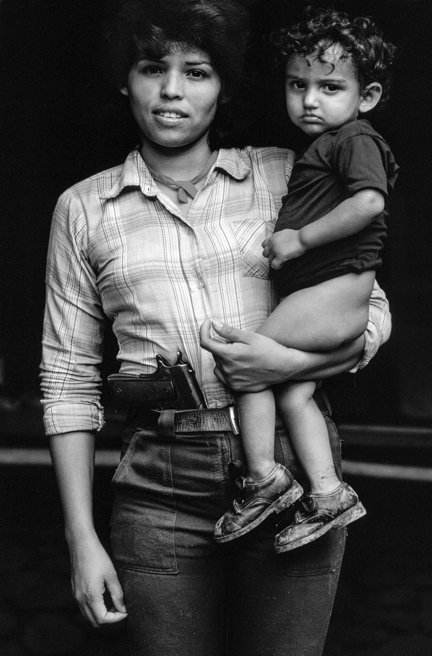 Teresa de Jesus Serrano, aged 22, with her young son. She made uniforms for the FPL guerrillas. Chalatenango, February 1984.