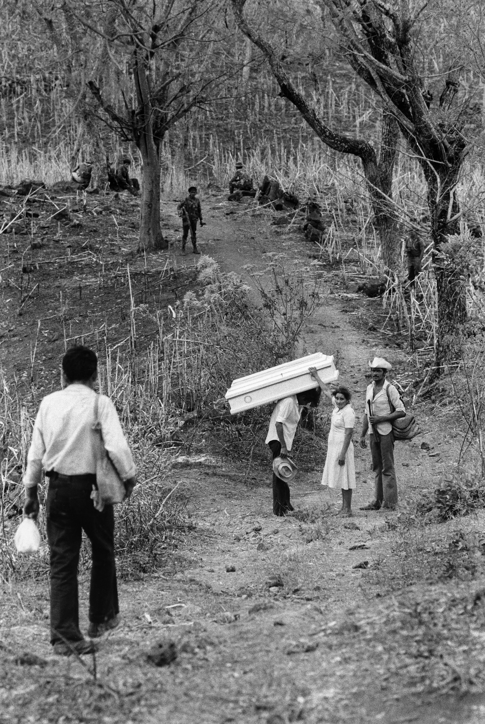 A family collect the body of their daughter - killed during a Salvadoran Air Force bombardment around the town of Carolina, Morazan. Badly injured, she had been evacuated by the army but was returned three days later in a coffin, March 1984.