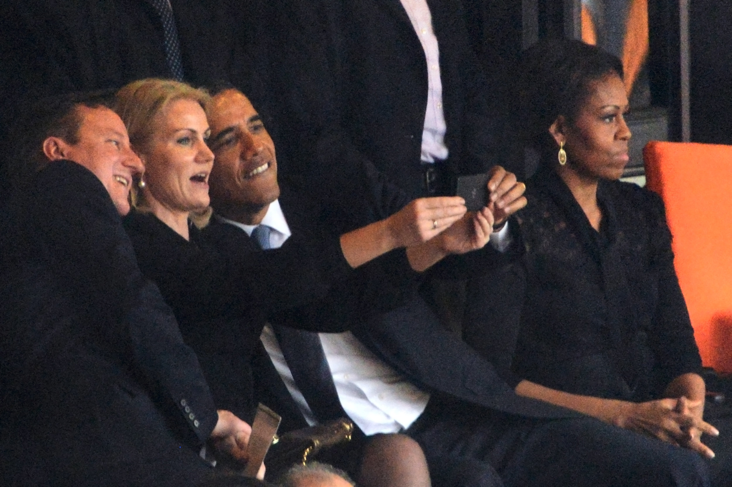 From left to right: David Cameron, Helle Thorning-Schmidt, Barack Obama and Michelle Obama at Nelson Mandela's funeral, 2013.