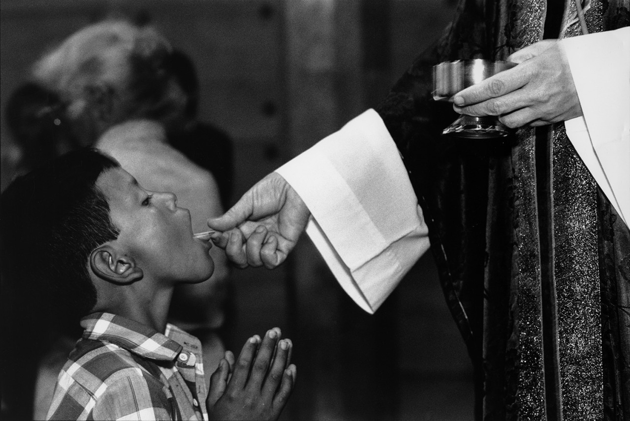 Sunday's church communion in El Salvador by Mike Goldwater.