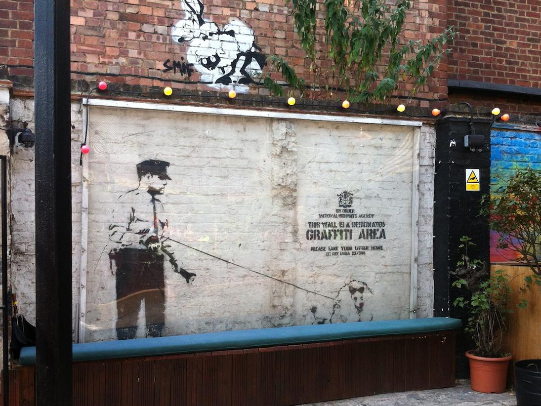 Designated Graffiti Area , Shoreditch, London by Banksy.