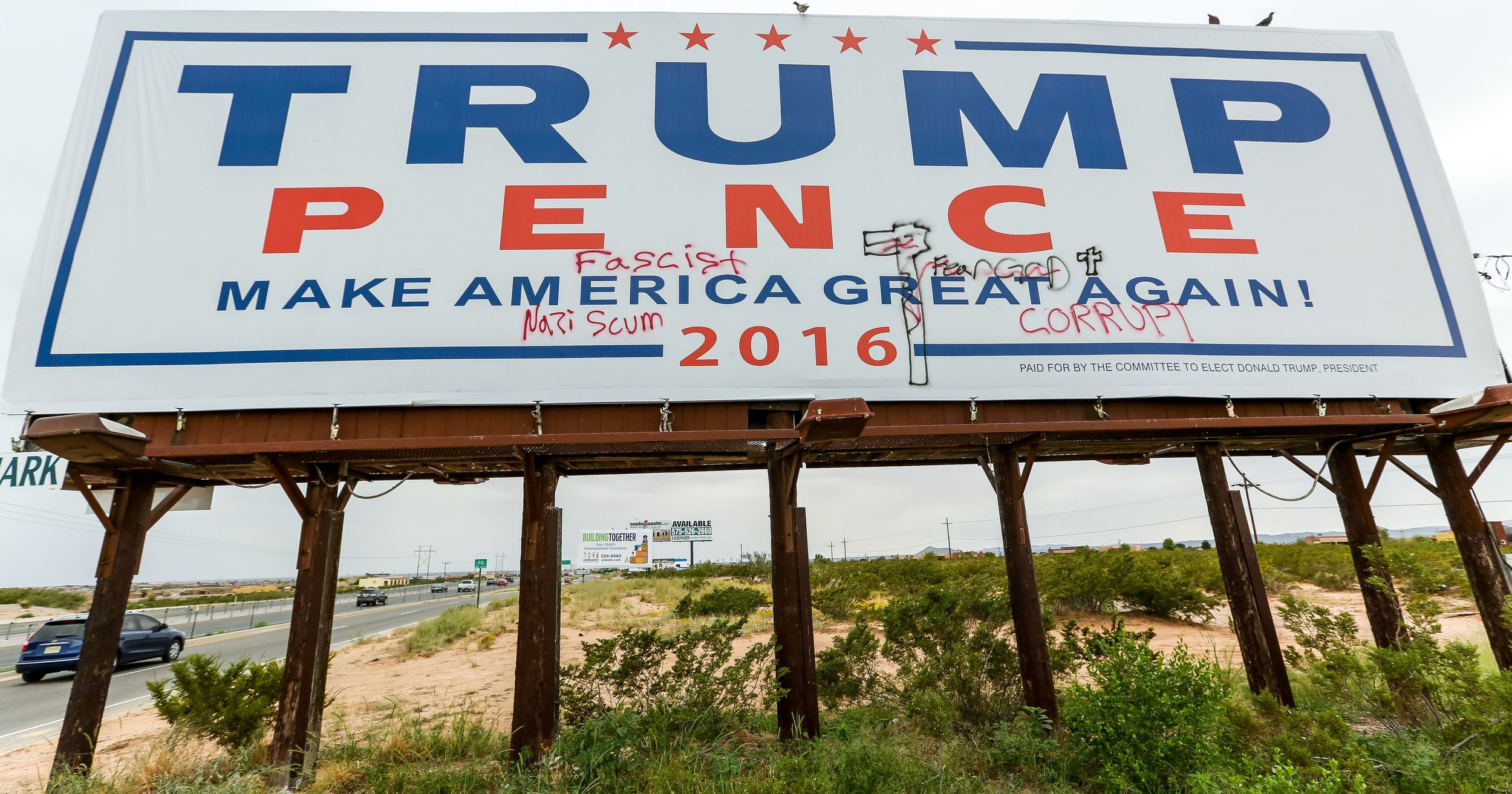 A Donald Trump billboard with  graffiti , posted on the westbound side of US 70 between Mesa Grande Avenue and Sonoma Ranch Boulevard. Photo by Robin Zielinski.