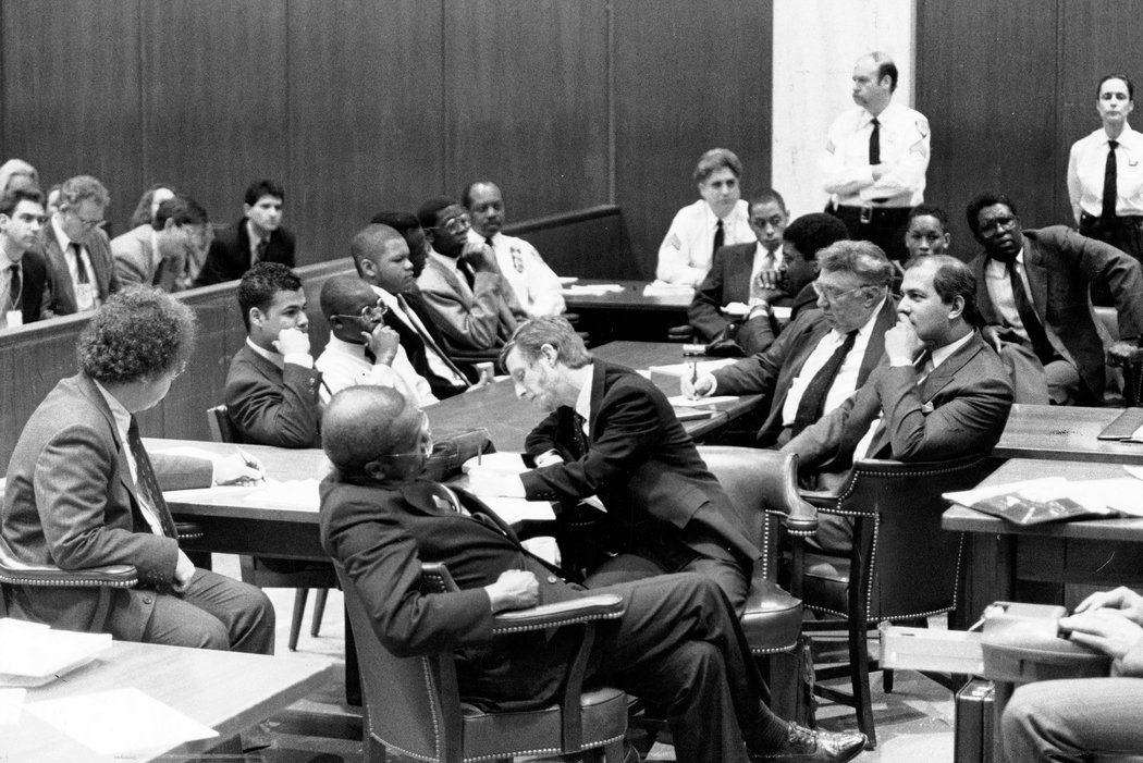 Lawyers, in foreground, and the five defendants in the Central Park rape case of a female jogger waiting for the ruling in February 1990 in State Supreme Court in Manhattan. Photo by James Estrin for The  New York Times .